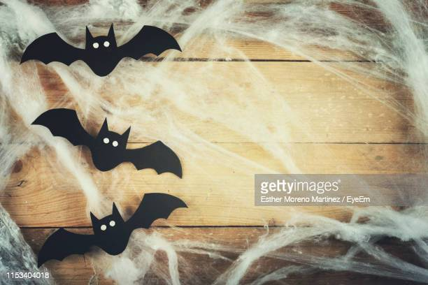 close-up of batman decorations on wall during halloween - halloween decoration stock pictures, royalty-free photos & images