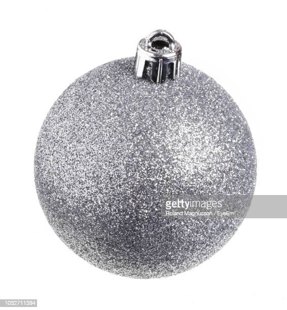 close-up of bauble against white background - christmas ornament stock pictures, royalty-free photos & images
