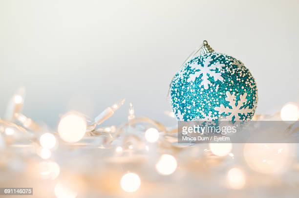 Close-Up Of Bauble By Illuminated Lighting Equipment