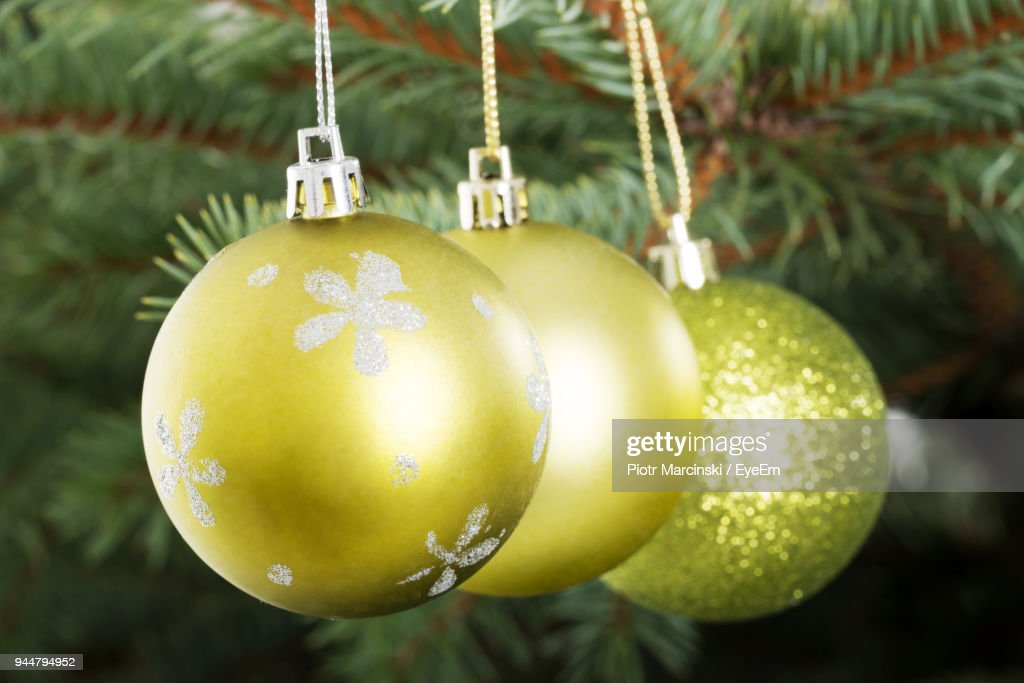 Close-Up Of Baubles Handing On Christmas Tree : Stock Photo