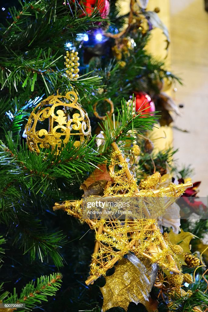 Close Up Of Baubles Hanging On Christmas Tree : Stock Photo