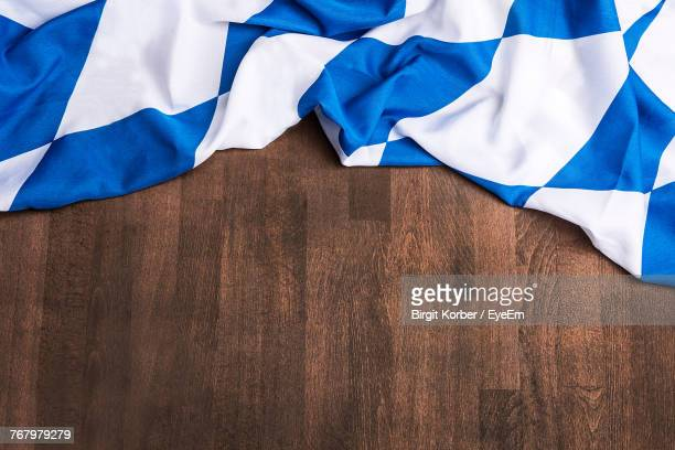 Close-Up Of Bavarian Flag On Hardwood Floor