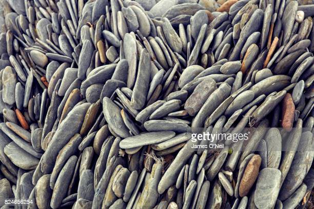 close-up of beach pebbles - image stock pictures, royalty-free photos & images