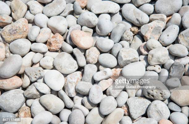 close-up of beach pebbles - pebble stock pictures, royalty-free photos & images