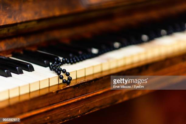 Close-Up Of Bead Necklace On Piano Keys