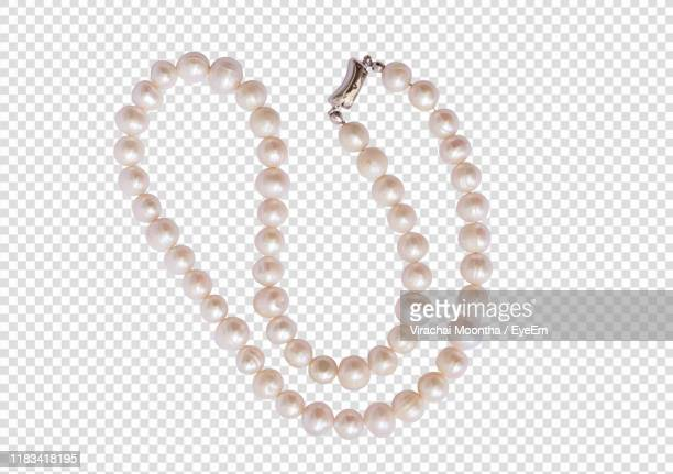 close-up of bead necklace - pearl jewelry stock pictures, royalty-free photos & images