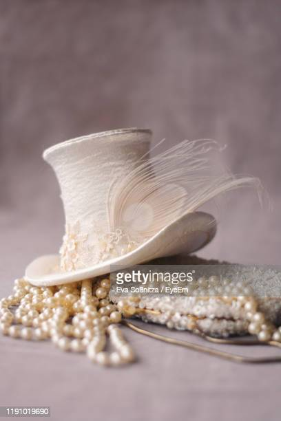 close-up of beads decoration on table - fascinator stock pictures, royalty-free photos & images