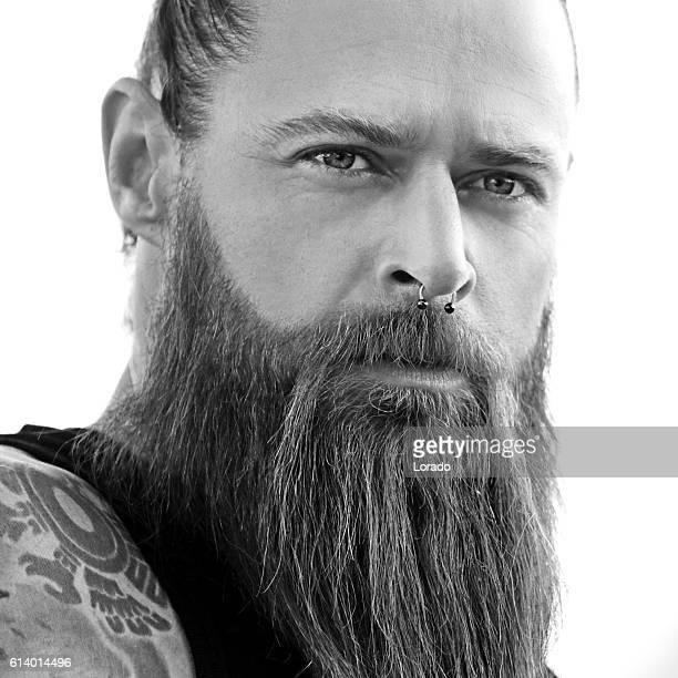 close-up of bearded tattooed handsome man - wikinger stock-fotos und bilder