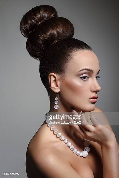 Close-Up Of Beautiful Fashion Model Against Gray Background