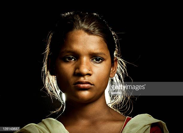 close-up of beautiful, rural indian girl looking at camera - high contrast stock pictures, royalty-free photos & images