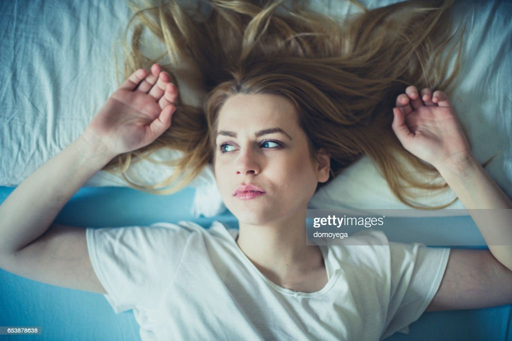 Close-up of beautiful sad woman in the bad : Stock Photo