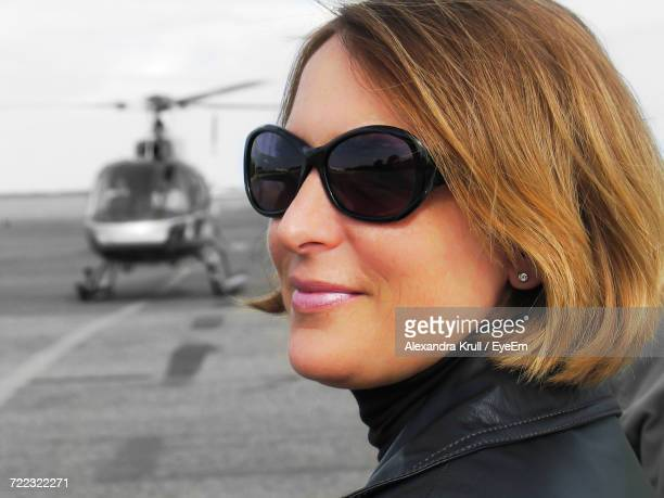 close-up of beautiful woman against helicopter - alexandra krull stock-fotos und bilder