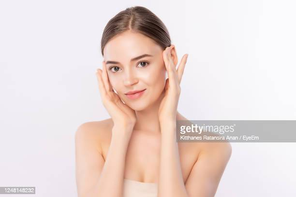 close-up of beautiful woman against white background - one young woman only stock pictures, royalty-free photos & images
