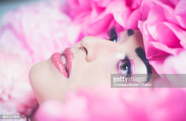 Close-Up Of Beautiful Woman Amidst Pink Flowers