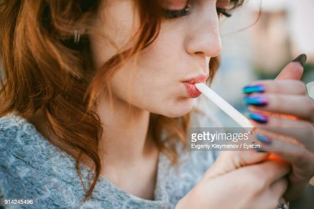 close-up of beautiful woman smoking cigarette - beautiful women smoking cigarettes stock pictures, royalty-free photos & images
