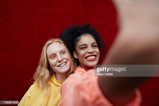 close-up of beautiful women photographing outdoors - person gemischter abstammung stock-fotos und bilder
