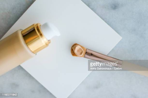 close-up of beauty products on table - concealer stock pictures, royalty-free photos & images