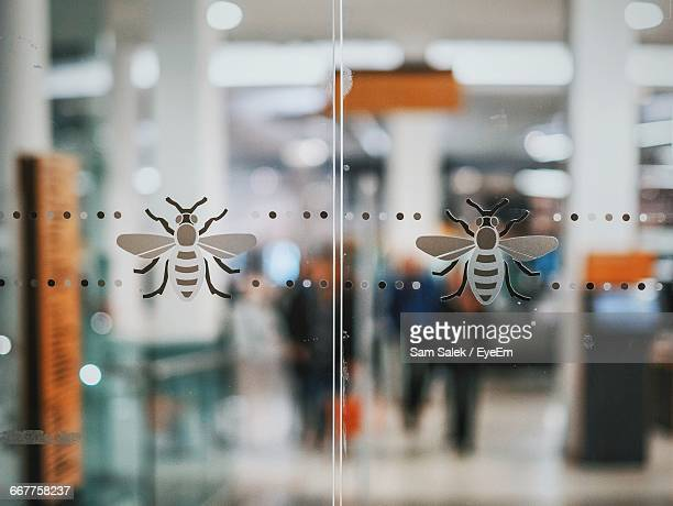 Close-Up Of Bee Shape Art On Glass
