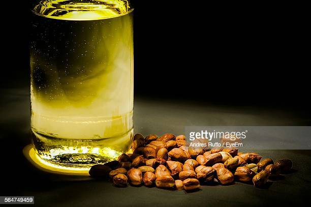 close-up of beer bottle with peanuts - andres ruffo stock photos and pictures