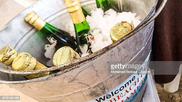 Close-Up Of Beer Bottles In Ice Bucket