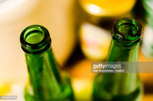 close-up of beer bottles on table - beer bottle stock pictures, royalty-free photos & images