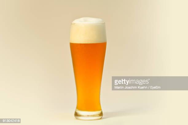 close-up of beer glass against white background - ビール ストックフォトと画像
