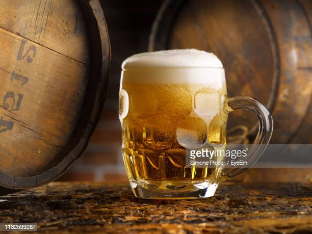 close-up of beer glass on floor - pint glass stock pictures, royalty-free photos & images