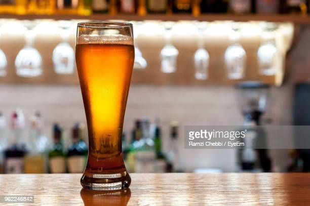 close-up of beer glass on table - ビアグラス ストックフォトと画像