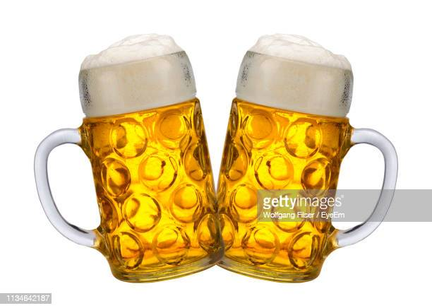 close-up of beer glasses against white background - beer glass stock pictures, royalty-free photos & images