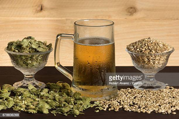 Close-Up Of Beer, Hops, And Malt On Table