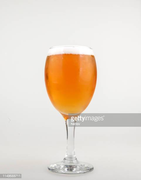 close-up of beer in glass against white background - ビアグラス ストックフォトと画像