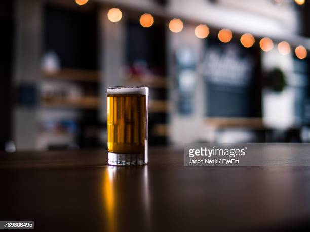 close-up of beer in glass on table - kneipe stock-fotos und bilder