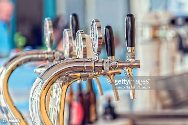 Close-Up Of Beer Taps In Bar
