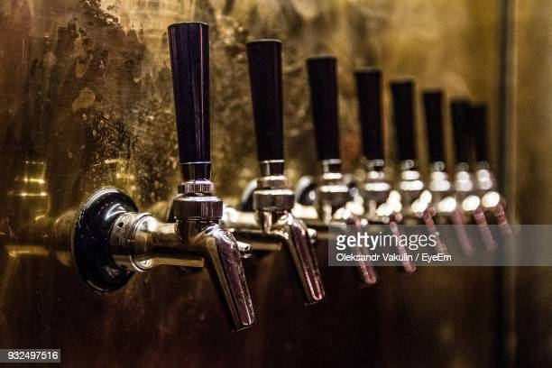 close-up of beer taps in bar - handle stock pictures, royalty-free photos & images