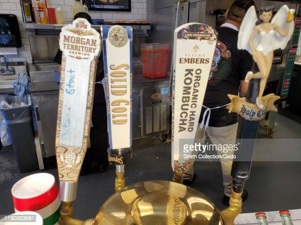 Closeup of beer taps with several craft beers as well as hard kombucha Walnut Creek California November 8 2019 The fermented drink is popular in the...