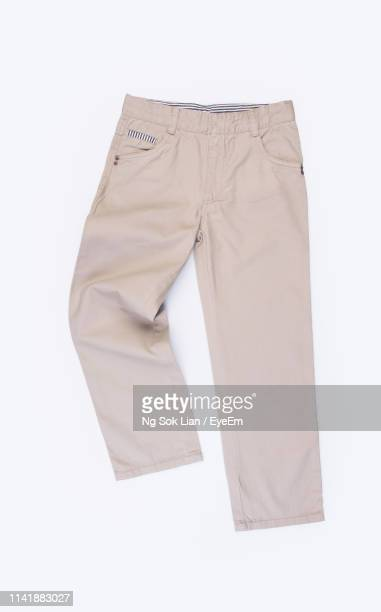 close-up of beige pants over white background - pants stock pictures, royalty-free photos & images
