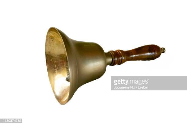 close-up of bell against white background - bell stock pictures, royalty-free photos & images