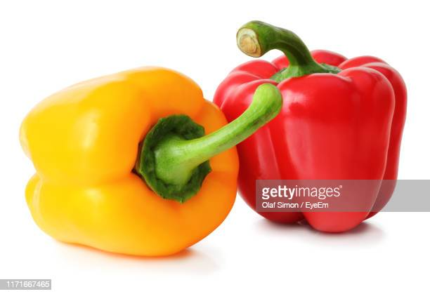close-up of bell peppers against white background - bell pepper stock pictures, royalty-free photos & images