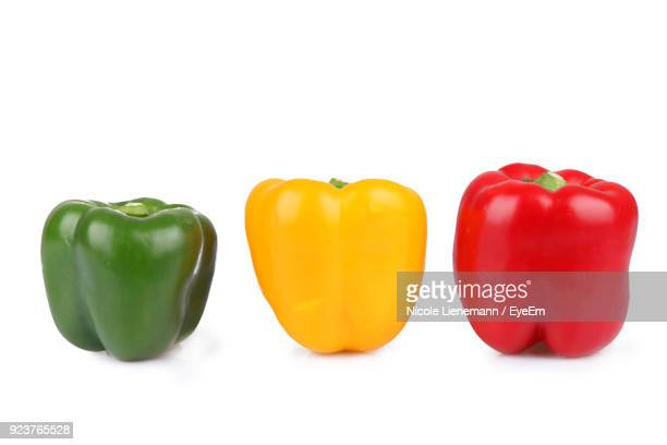 close-up of bell peppers against white background - pimientos fotografías e imágenes de stock
