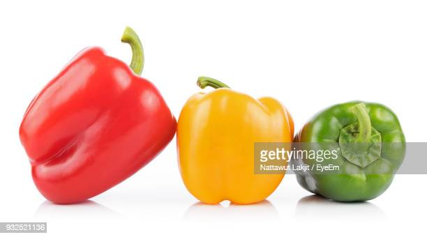 close-up of bell peppers against white background - yellow bell pepper stock pictures, royalty-free photos & images