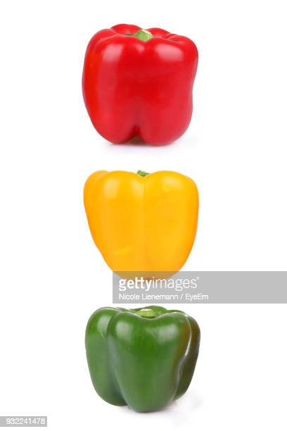 close-up of bell peppers over white background - green bell pepper stock pictures, royalty-free photos & images