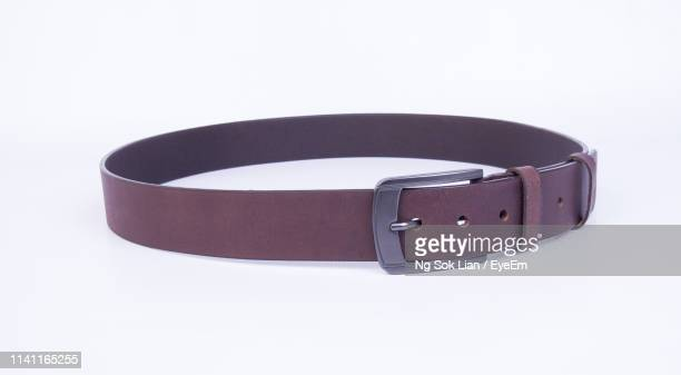 close-up of belt on white background - leather belt stock pictures, royalty-free photos & images
