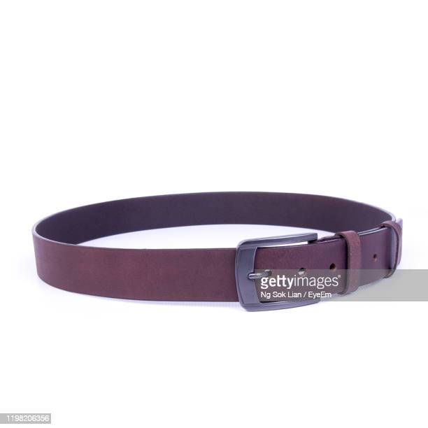 close-up of belt over white background - brown belt stock pictures, royalty-free photos & images