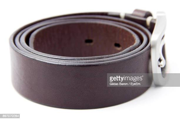 Close-Up Of Belt Over White Background