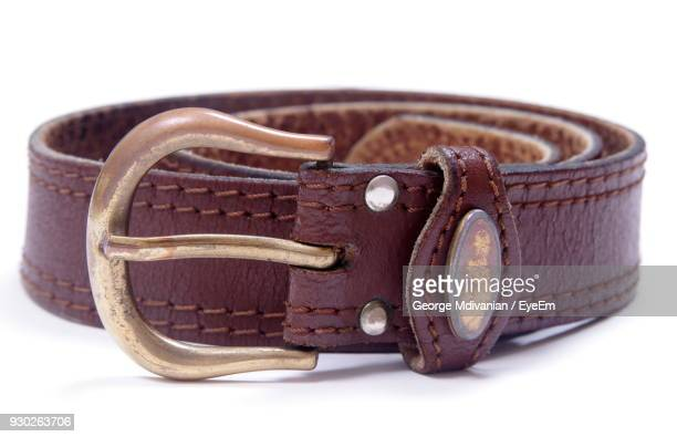 close-up of belt over white background - leather belt stock pictures, royalty-free photos & images