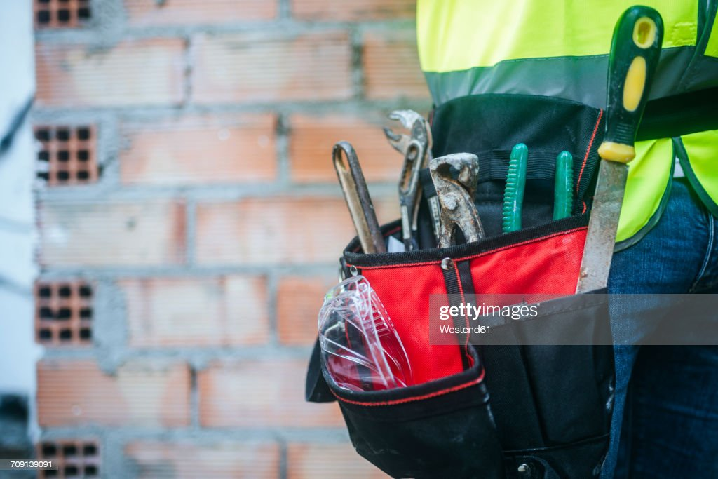 Close-up of belt with construction tools : Stock Photo