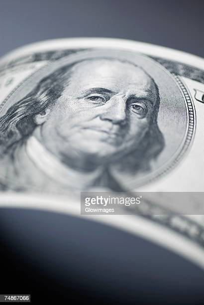 Close-up of Benjamin Franklin on an one hundred dollar bill