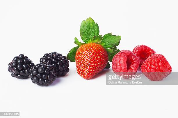 close-up of berries over white background - blackberry fruit stock pictures, royalty-free photos & images