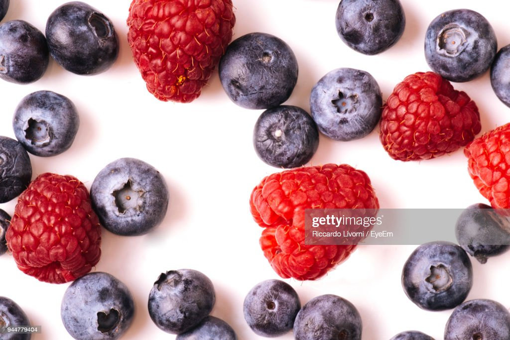 Close-Up Of Berry Fruits Against White Background : Stock Photo