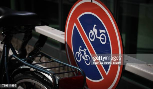 Close-Up Of Bicycle By No Parking Sign